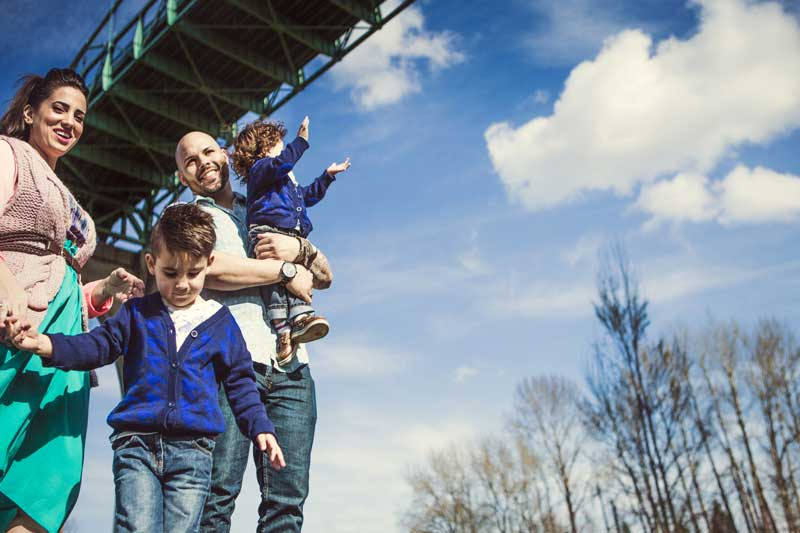 Portland Family under a bridge on a clear day.